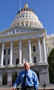 Calonomics editor Ron Trujillo at the west side of the state Capitol. Photo courtesy of Patricia Snider.